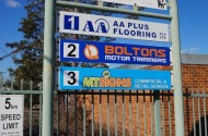 AA Plus Flooring Street Sign